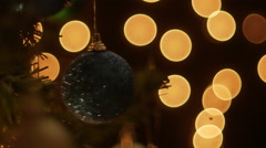 Christmas ball on tree with bokeh background. Stock Footage