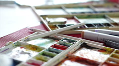 Art at home watercolor and painting equipments. colorful palettes and markers Stock Footage