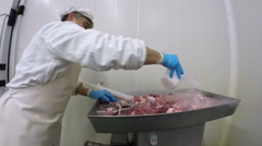 Butcher Pouring Dry Ice on Fresh Meat Stock Footage