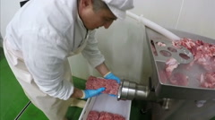Worker Mincing Meat with Mincer Machine Stock Footage