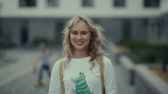 Portrait of youth russian woman. Pretty blonde in fashionable clothes Stock Footage