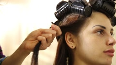 Hairdo. hairdresser's hands to work on client's hair at salon Stock Footage