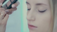 Make-up artist does pearlescent shade on the eyelid using a brush Stock Footage