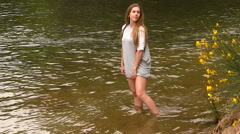 Attractive Caucasian Teen Girl Standing In River With Gray Dress Stock Footage