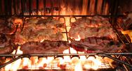 Excellent meat grilled chicken in the fireplace of restaurant Stock Photos