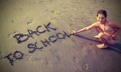Babe writes the Back to School on the beach in summer Stock Photos