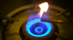 Hand lighting gas burner slow motion Stock Footage
