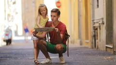 Adorable little girl and father with map of european city outdoors in Rome Stock Footage