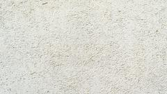 Surface of the wall, covered with textured plaster with small bumps and prick Stock Photos