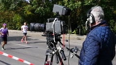 Sofia Bulgaria annual marathon - cameraman with professional TV camera shooting Stock Footage