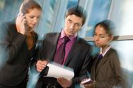 Three business people working together Stock Photos