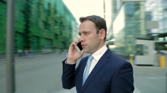 Man talking on the phone. Camera moves around the man Stock Footage