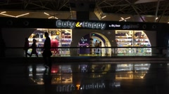 People visit duty free shop in Vnukovo airport at evening Stock Footage