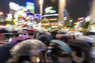 Motion Blurred People in Rain on Shibuya Crossing, Tokyo, Japan Stock Photos