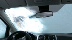 Cleaning Car Windshield of Snow. Inside View Stock Footage