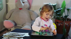 Little girl works with digital tablet. Stock Footage