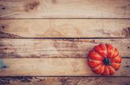 Autumn background with pumpkin on wooden board with space, Vintage filter. Stock Photos