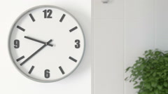 Office Clocks on white wall - timelapse Stock Footage