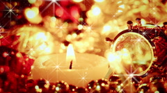 Candle and christmas lights close-up seamless loop Stock Footage