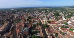 Bird's-eye panoramic view to roofs of ancient houses, main roads, buildings and Stock Footage