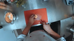 Chef cuts the vegetables and fry them in a pan Stock Footage