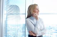 A secretary calling by mobile phone in the room Stock Photos