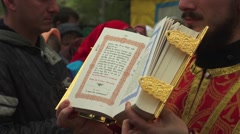 The open book of the gospel during the service on the street Stock Footage