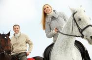 Two young people going on horseback Stock Photos