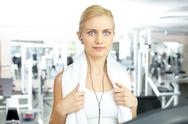 A beautiful blue-eyed girl in gym looking at camera Stock Photos
