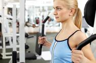 Young woman training in gym Stock Photos