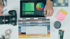 Top view. Artist, graphic designer working with colors at desk from above Stock Footage