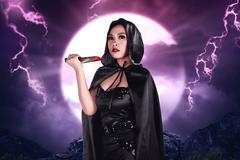 Young beautiful asian witch holding bloody knife Stock Photos