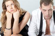 Two valentines sitting together displeased and looking away Stock Photos