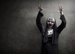 Young evil asian woman nun scare Stock Photos