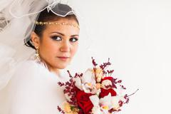 Portrait of bride with the flower bouquet in winter time Stock Photos