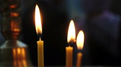 Hot Flames of Three Candles Isolated in Black Background Dark Room Stock Footage