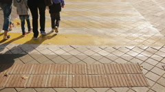 Foot crosswalk. People cross the road. feet walking on the pavement. Stock Footage
