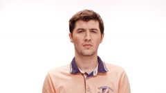 Displeased young handsome man listening refusing over white background Stock Footage