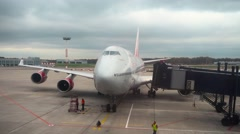 Gangways moving to big passenger aircraft in Vnukovo airport Stock Footage
