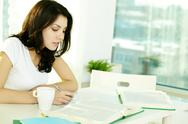 High school student working with dictionaries at home Stock Photos