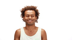 African man smiling enjoying moving over white background Slow motion Stock Footage