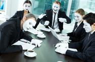 Business team of mimes sitting in board room and communicating Stock Photos