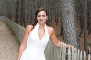 Caucasian young brunette bride, outside portrait on path Stock Photos