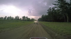 Boys ATV riding in the field Stock Footage
