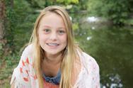 Portrait of pretty teen girl with dental braces. Stock Photos