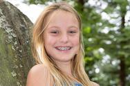 Portrait of smiling teen girl showing dental braces Stock Photos