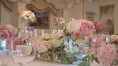Bouquets of Flowers in Vases on a Table Stock Footage