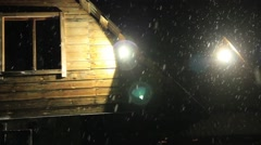 Many snow flakes falling from sky on a black background and bright lamp. snow Stock Footage