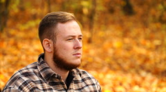 Footage a man putting on sunglasses outdoors in autumn. 4K Stock Footage