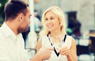 Smiling couple drinking champagne at cafe Stock Photos